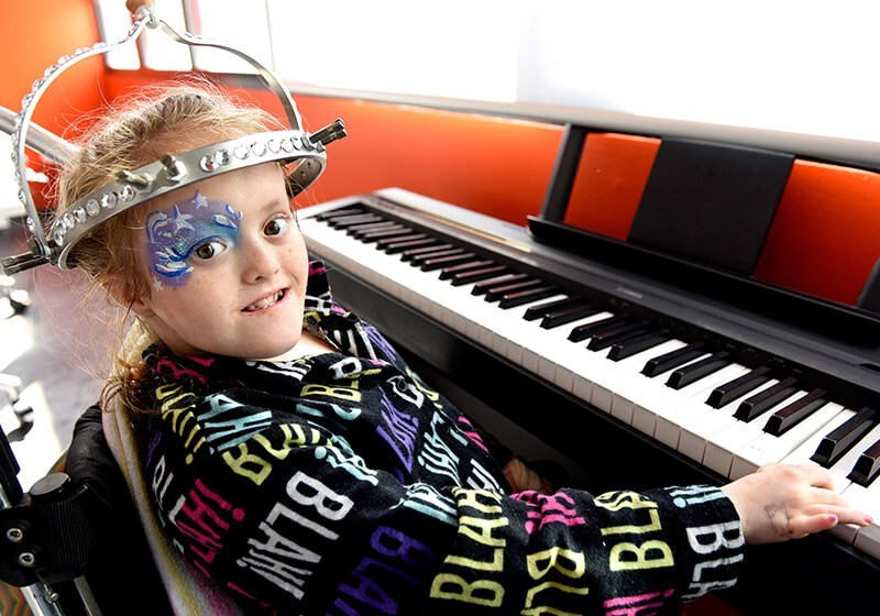 Sydney Children's Hospital patient playing a keyboard