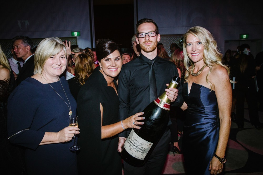 Guests holding champagne bottle