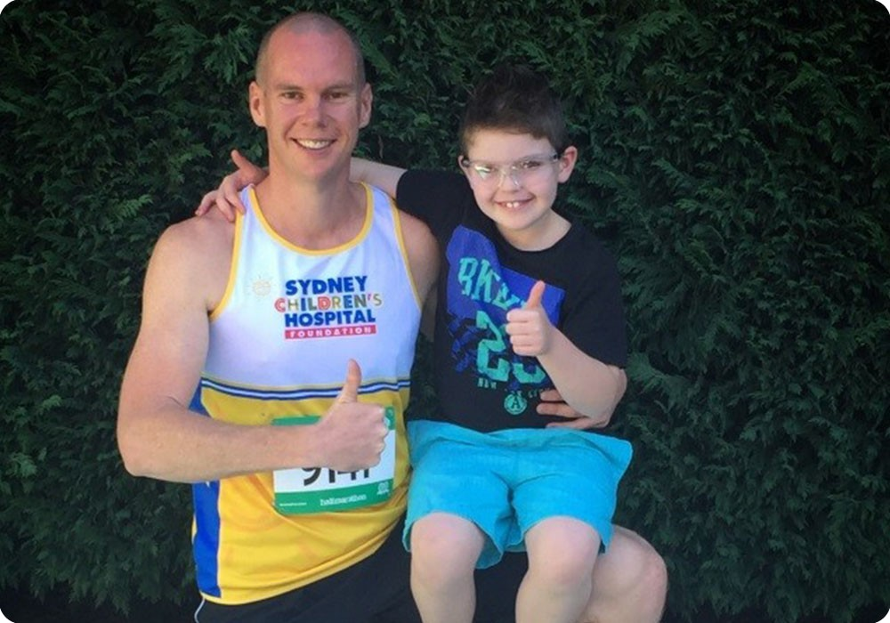 SMH Half Marathon runner with child - Sydney Children's Hospital Foundation