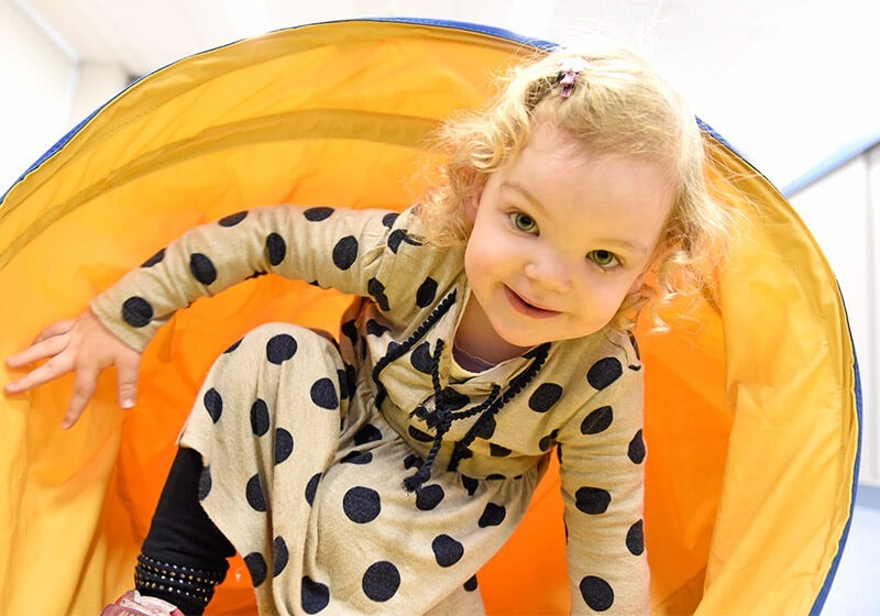 Patient smiling in play tunnel - Sydney Children's Hospital Foundation