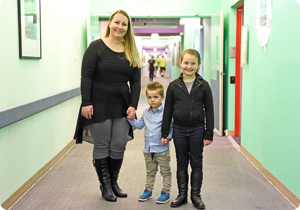 Mother and her children in hospital corridor