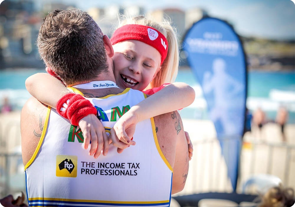 Team Kids runner at the City2Surf hugging his daughter