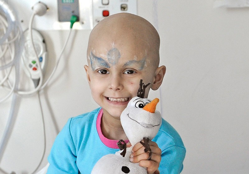 Patient holding a snowman toy - Sydney Children's Hospital Foundation
