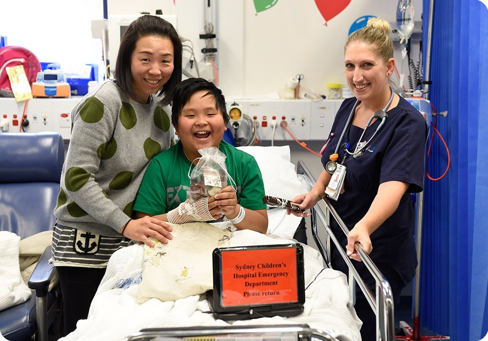 Mother and son smiling with nurse at Sydney Children's Hospital, Randwick