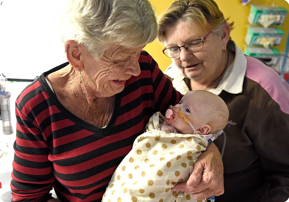 Grandmother holding newborn - Sydney Children's Hospital Foundation