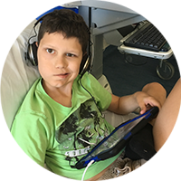 Patient Caleb playing on his Ipad- Sydney Children's Hospital Foundation